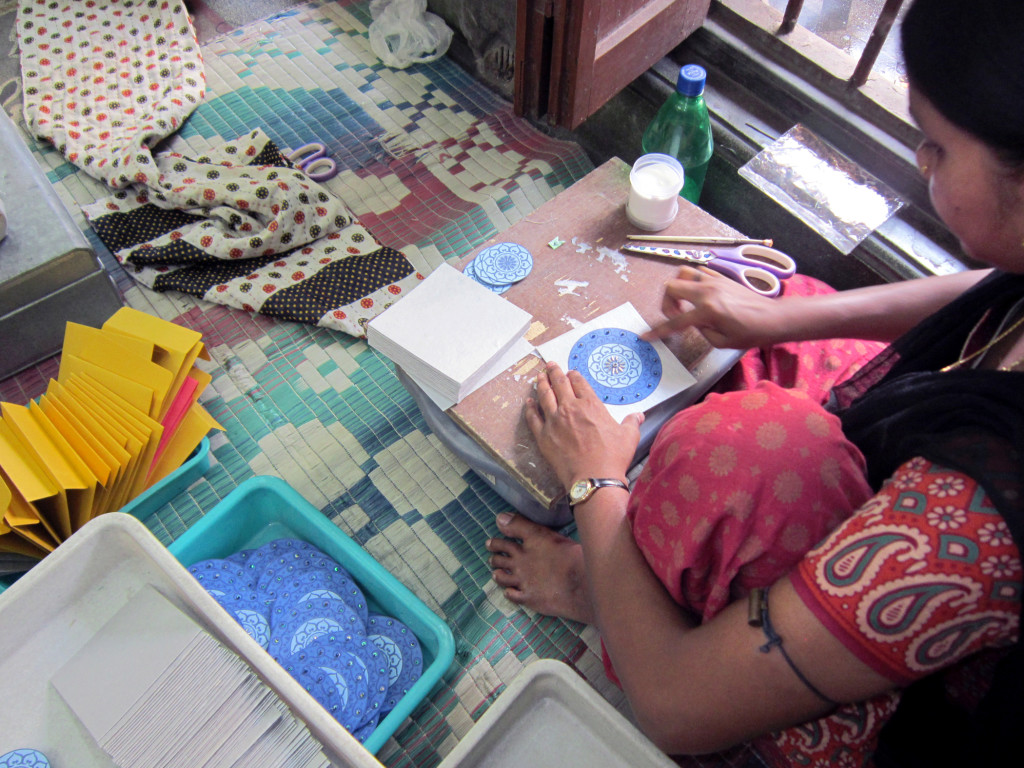 Image of Indian woman making cards.