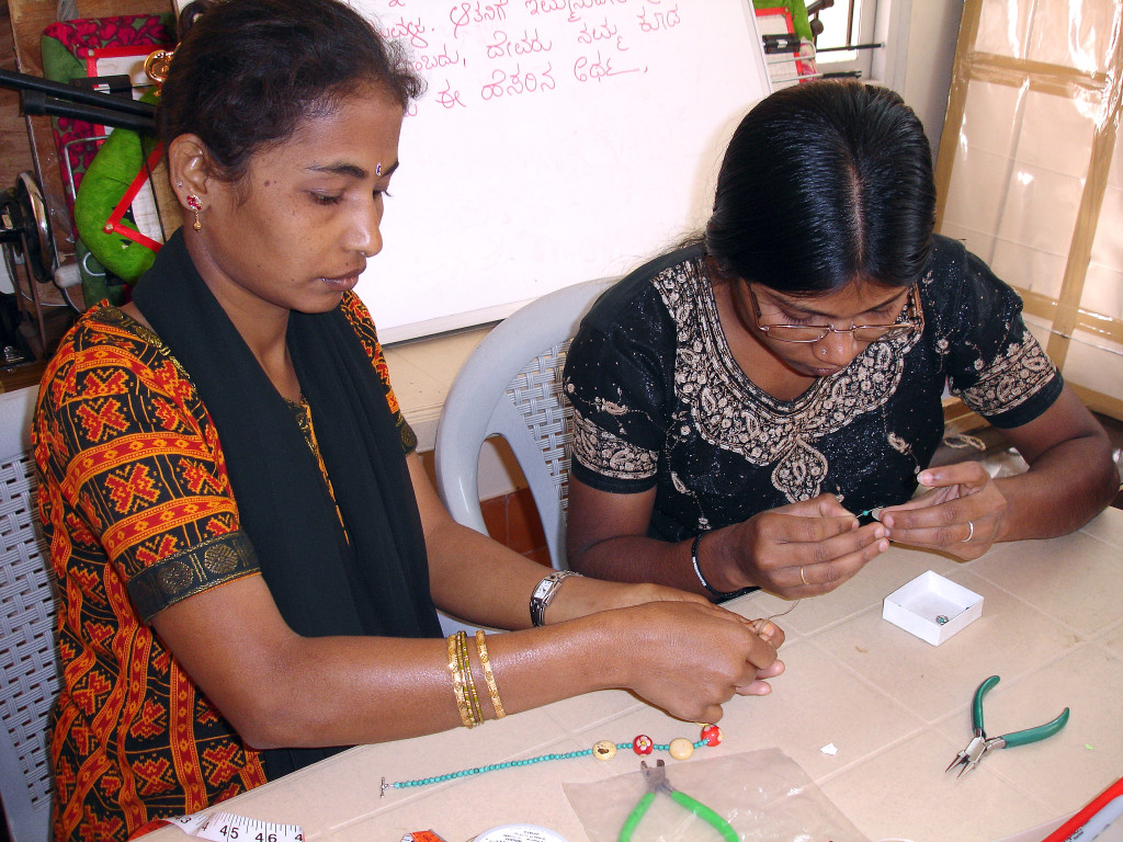 image of two Indian women making jewelry