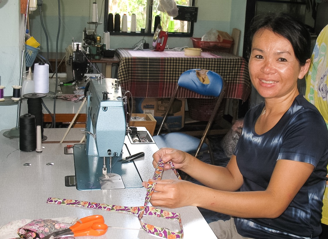 An artisan employed at WorldCrafts' first artisan group, Thai Country Trim in Bangkla, Thailand.