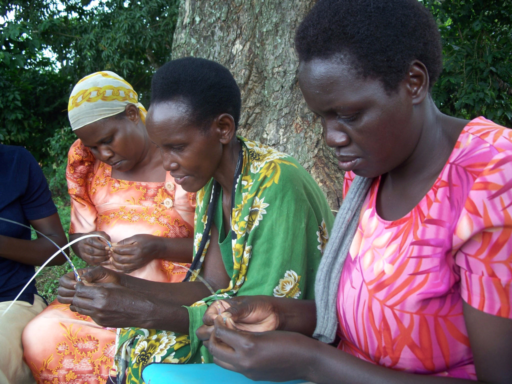 image of 3 Ugandan women making paper beads